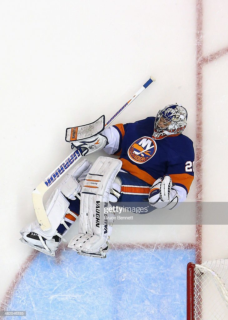 Evgeni Nabokov #20 of the New York Islanders tends net against the Florida Panthers at the Nassau Veterans Memorial Coliseum on April 1, 2014 in Uniondale, New York. The Islanders defeated the Panthers 4-2.