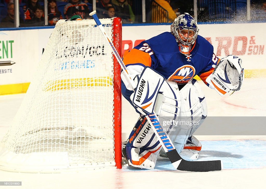 Evgeni Nabokov #20 of the New York Islanders tends net against the Buffalo Sabres during their game at Nassau Veterans Memorial Coliseum on February 9, 2013 in Uniondale, New York.