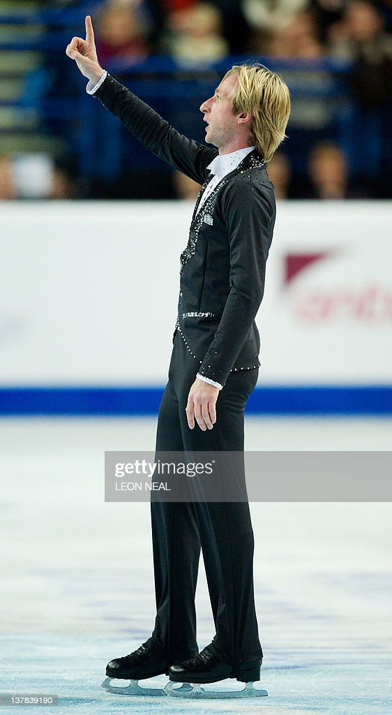 Evgeni Plushenko of Russia celebrates a successful performance in the Mens Free Skating on day six of the ISU European Figure Skating Championships at the Motorpoint Arena in Sheffield, north England, on January 28, 2012.