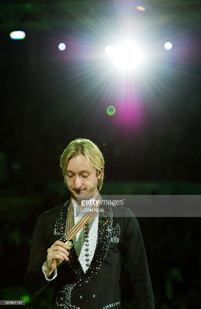 Evgeni Plushenko of Russia celebrates after taking the gold medal in the Mens Free Skating on day six of the ISU European Figure Skating Championships at the Motorpoint Arena in Sheffield, north England, on January 28, 2012. AFP PHOTO / LEON NEAL
