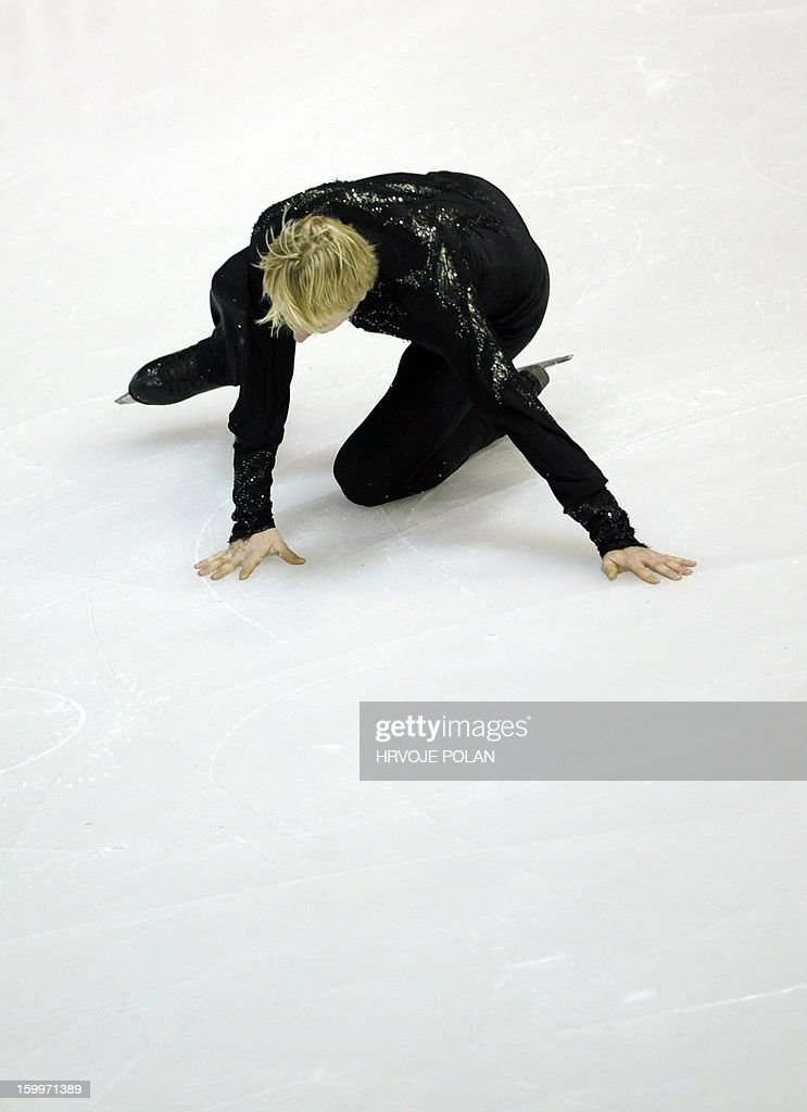 Evgeni Plushenko of Russia falls as he performs during the men's short program at the European Figure Skating Championships in Zagreb on January 24, 22013.