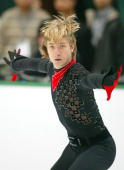 Evgeni Plushenko of Russia performs during the men's free skating at the 2004/2005 ISU Grand Prix of Figure Skating Final on December 18 2004 in...