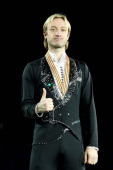 Evgeni Plushenko of Russia poses with the Gold medal after winning the Mens Ice Dance Free Dance during the ISU European Figure Skating Championships...