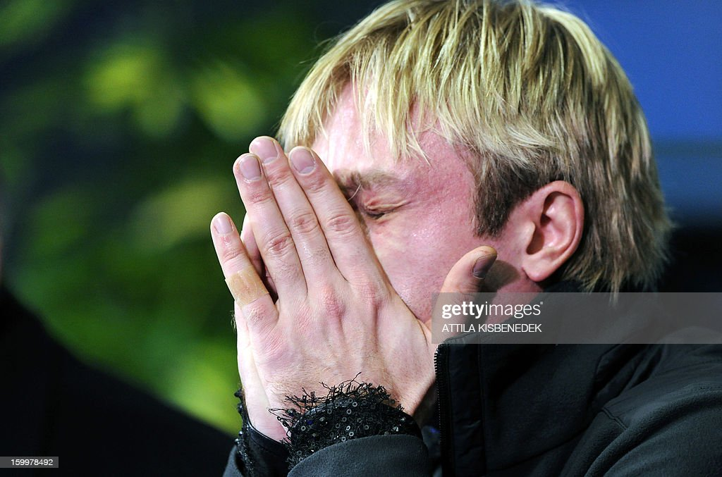 Evgeni Plushenko of Russia reacts after performing his men short program routine during the ISU European Figure Skating Championships at the 'Dom Sportova' sports hall in Zagreb on January 24, 2013. AFP PHOTO / ATTILA KISBENEDEK