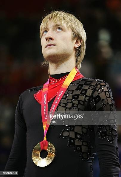 Evgeni Plushenko of Russia stands on the podium after winning the gold medal in Men's Figure Skating following the Men's Free Skate Program Final...