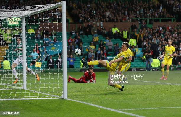 Evgeni Postnikov of FC Astana scores an own goal during the UEFA Champions League Qualifying PlayOffs Round First Leg match between Celtic FC and FK...