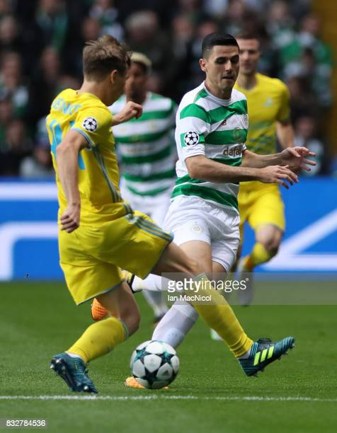 Evgeni Postnikov of FC Astana vies with Tomas Rogic of Celtic during the UEFA Champions League Qualifying PlayOffs Round First Leg match between...