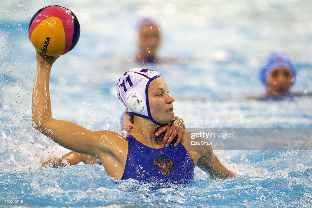 Evgenia Ivanova of Russia looks to pass in the Women's Water Polo bronze medal match between Russia and Italy during Day Fourteen of the 14th FINA...