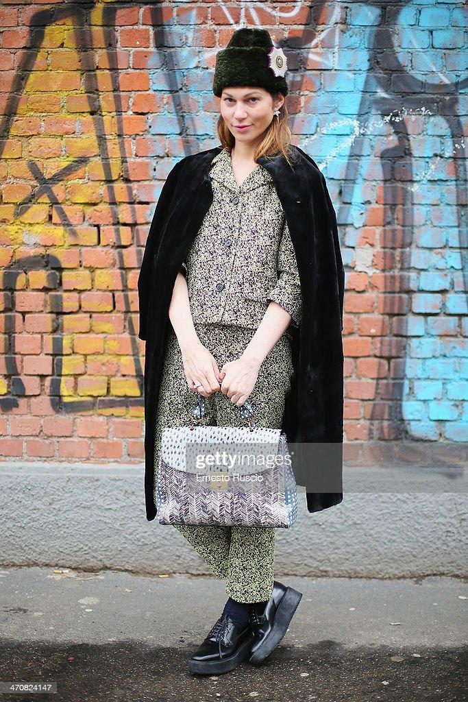 Evgenia Linovich wears Marni dress, Marc Jacobs bag and Prada shoes outside the Fendi Fashion Show on day 2 of Milan Fashion Week Womenswear Autumn/Winter 2014 on February 20, 2014 in Milan, Italy.