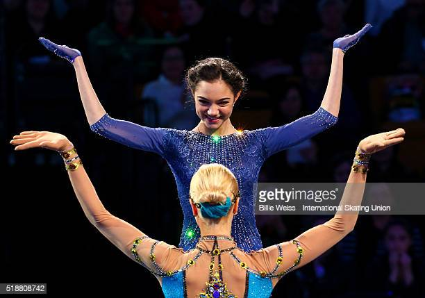 Evgenia Madvedeva of Russia and Anna Pogorilaya of Russia react after earning gold and silver medals in the ladies free skate during Day 6 of the ISU...