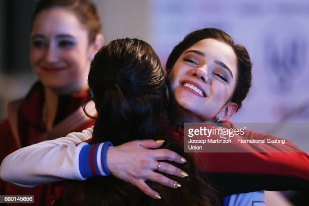 Evgenia Medvedeva of Russia congratulates Gabrielle Daleman of Canada in the Ladies Short Program press conference during day one of the World Figure...