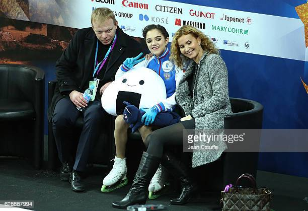 Evgenia Medvedeva of Russia poses between her coaches Sergei Dudakov and Eteri Tutberidze following Senior Ladies Short Program on day two of the ISU...