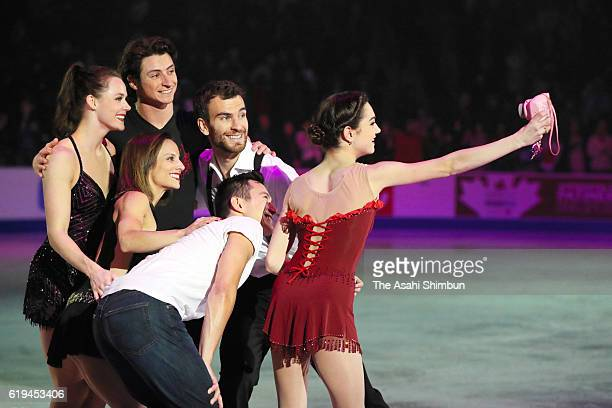 Evgenia Medvedeva of Russia takes selfie photographs with Partick Chan Tessa Virtue Scott Moir Meagan Duhamel and Eric Radford of Canada at the...
