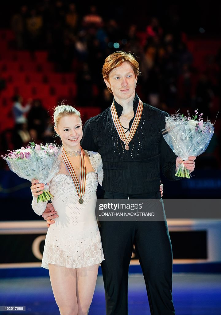 Evgenia Tarasova and <a gi-track='captionPersonalityLinkClicked' href=/galleries/search?phrase=Vladimir+Morozov&family=editorial&specificpeople=6614710 ng-click='$event.stopPropagation()'>Vladimir Morozov</a> of Russia celebrate with their bronze medals after performing at the pairs free skating category of the ISU European Figure Skating Championships on February 1, 2015 in Stockholm. AFP PHOTO/JONATHAN NACKSTRAND