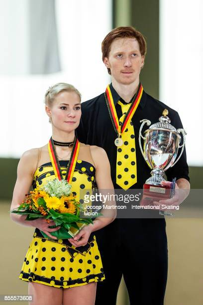 Evgenia Tarasova and Vladimir Morozov of Russia hold the trophy in the Pairs medal ceremony during the Nebelhorn Trophy 2017 at Eissportzentrum on...