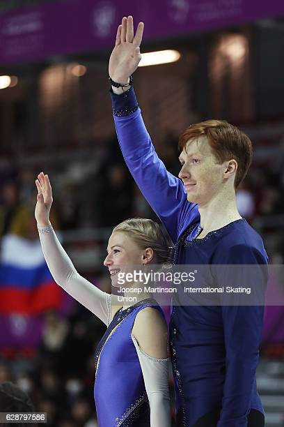 Evgenia Tarasova and Vladimir Morozov of Russia pose during Senior Pairs medal ceremony on day two of the ISU Junior and Senior Grand Prix of Figure...