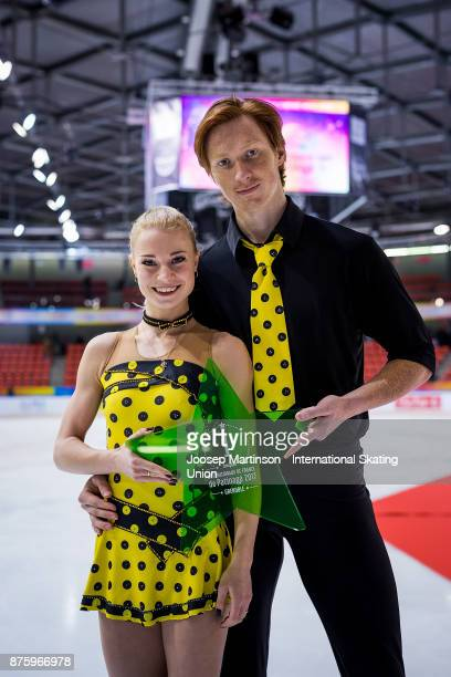 Evgenia Tarasova and Vladimir Morozov of Russia pose in the pairs medal ceremony during day two of the ISU Grand Prix of Figure Skating at Polesud...