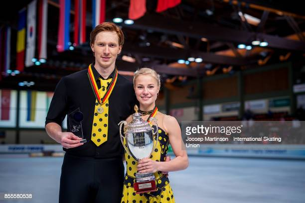 Evgenia Tarasova and Vladimir Morozov of Russia pose with the trophy in the Pairs medal ceremony during the Nebelhorn Trophy 2017 at Eissportzentrum...