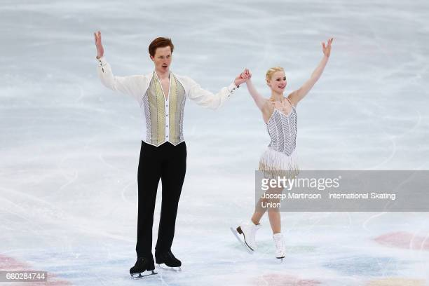 Evgenia Tarasova and Vladimir Morozov of Russia react in the Pairs Short Program during day one of the World Figure Skating Championships at Hartwall...