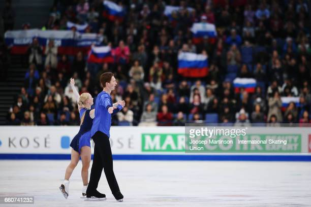 Evgenia Tarasova and Vladimir Morozov of Russia react in the Pairs Free Skating during day two of the World Figure Skating Championships at Hartwall...