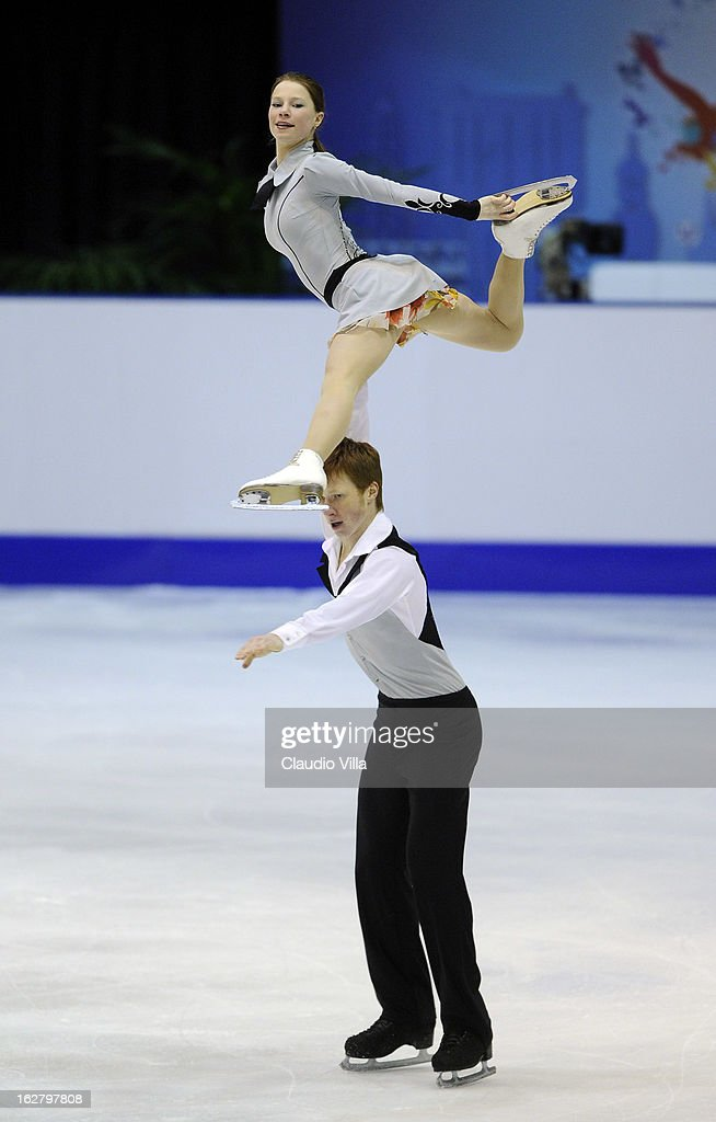 Evgenia Tarasova and Vladimir Morozov of Russia skate in the Pairs Short Program during day 3 of the ISU World Junior Figure Skating Championships at Agora Arena on February 27, 2013 in Milan, Italy.