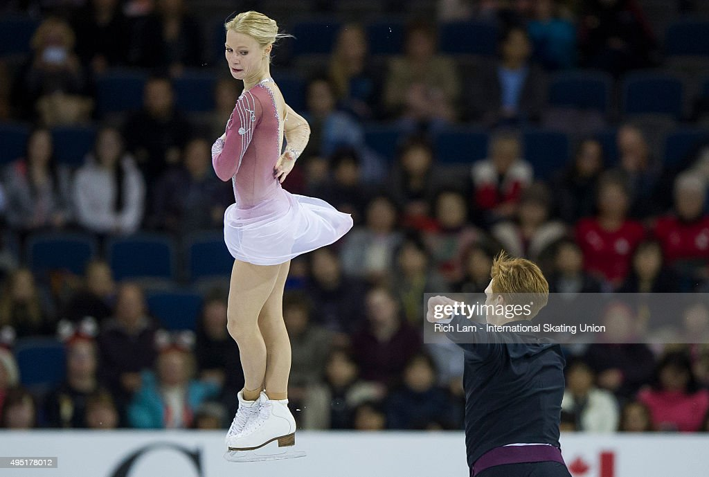 Evgenia Tarasova of Russia is thrown by partner <a gi-track='captionPersonalityLinkClicked' href=/galleries/search?phrase=Vladimir+Morozov&family=editorial&specificpeople=6614710 ng-click='$event.stopPropagation()'>Vladimir Morozov</a> during the Pairs Free Skate on day two of Skate Canada International ISU Grand Prix of Figure Skating, October, 31, 2015 at ENMAX Centre in Lethbridge, Alberta, Canada.