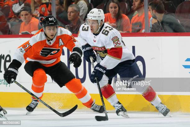 Evgenii Dadonov of the Florida Panthers controls the puck against Valtteri Filppula of the Philadelphia Flyers on October 17 2017 at the Wells Fargo...