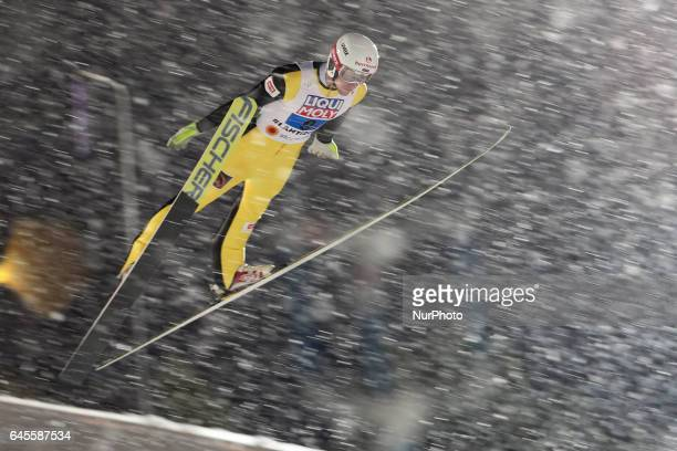 Evgeniy Klimov competes in the Mixed Team HS100 Normal Hill Ski Jumping during the FIS Nordic World Ski Championships on February 26 2017 in Lahti...
