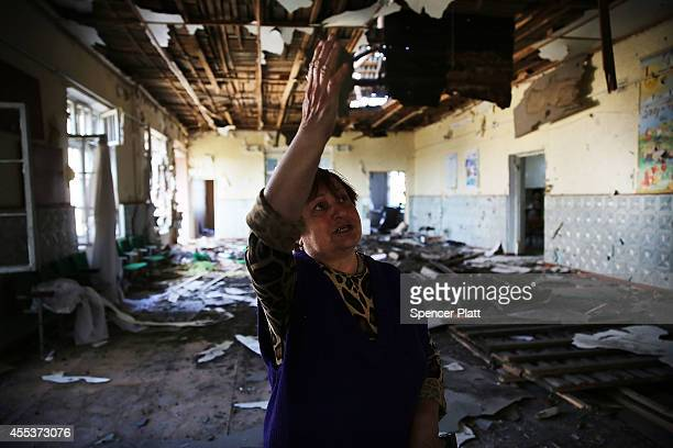 Evgeniya Bshinichenko stands in the destroyed school where she was the headmaster in the battered city of Lugansk on September 13 2014 in Lugansk...