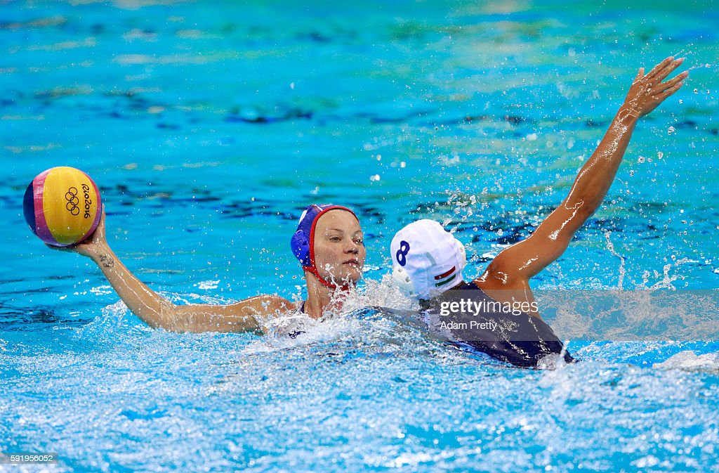 Evgeniya Ivanova of Russia is challenged by Rita Keszthelyi of Hungary during the Women's Water Polo Bronze Medal match between Hungary and Russia on...