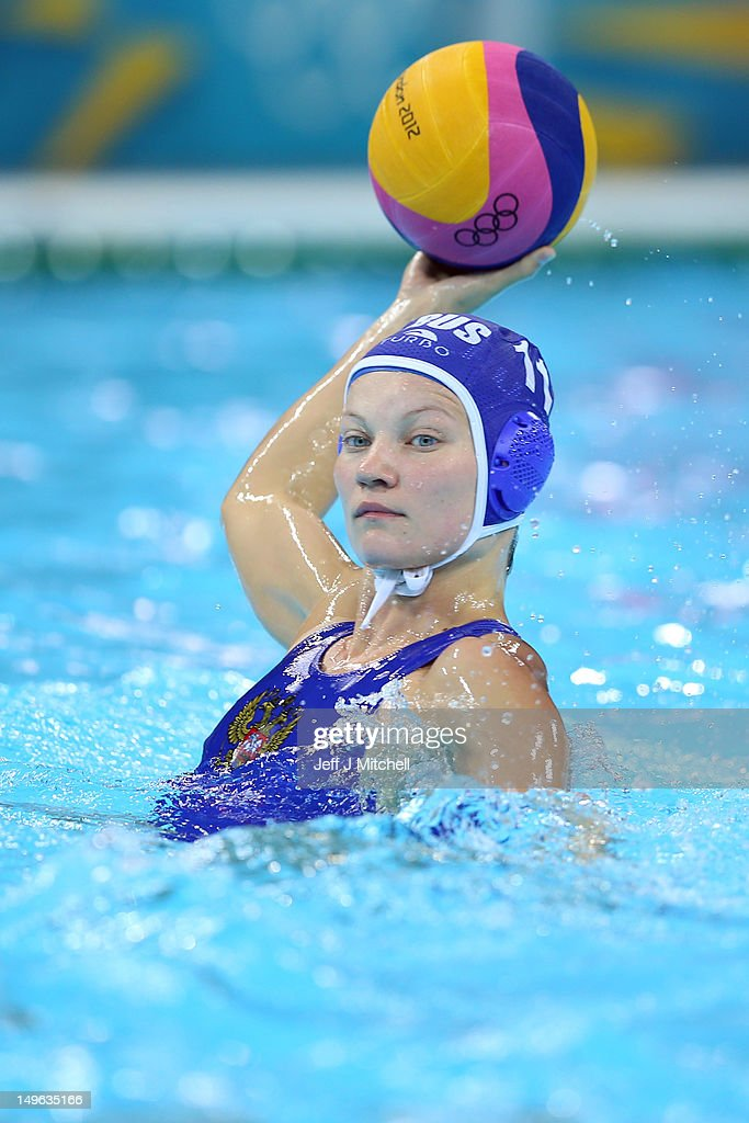 Evgeniya Ivanova of Russia passes the ball in the Women's Preliminary Round match between Italy and Russia on Day 5 of the London 2012 Olympics at...