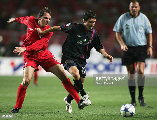 Evgeny Aldonin of CSKA Moscow is tackled by Dietmar Hamann of Liverpool during the UEFA Super Cup match between Liverpool and CSKA Moscow at the...