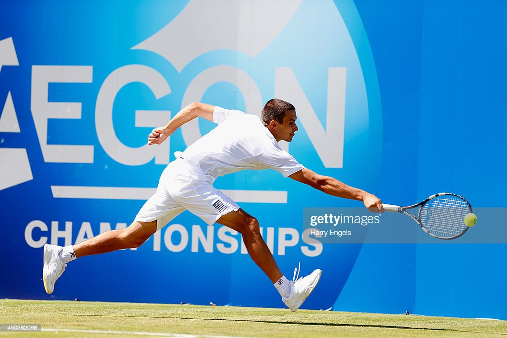 <a gi-track='captionPersonalityLinkClicked' href=/galleries/search?phrase=Evgeny+Donskoy&family=editorial&specificpeople=5368047 ng-click='$event.stopPropagation()'>Evgeny Donskoy</a> of Russia in action against Edouard Roger-Vasselin of France during their Men's Singles match on day two of the Aegon Championships at Queens Club on June 10, 2014 in London, England.