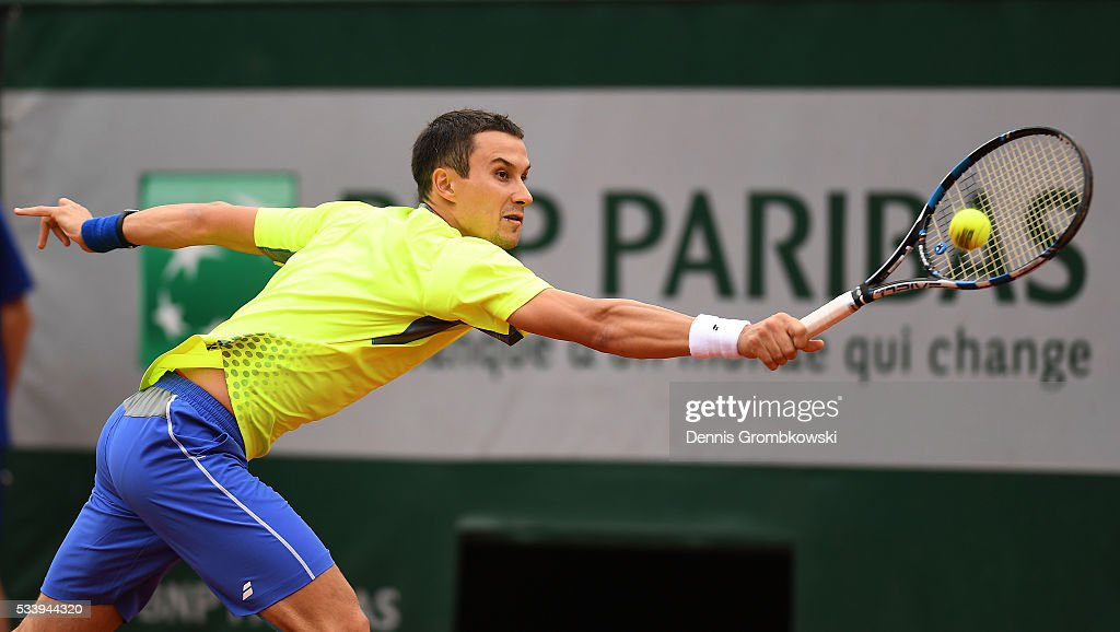 <a gi-track='captionPersonalityLinkClicked' href=/galleries/search?phrase=Evgeny+Donskoy&family=editorial&specificpeople=5368047 ng-click='$event.stopPropagation()'>Evgeny Donskoy</a> of Russia plays a backhand during the Men's Singles first round match against David Ferrer of Spain on day three of the 2016 French Open at Roland Garros on May 24, 2016 in Paris, France.