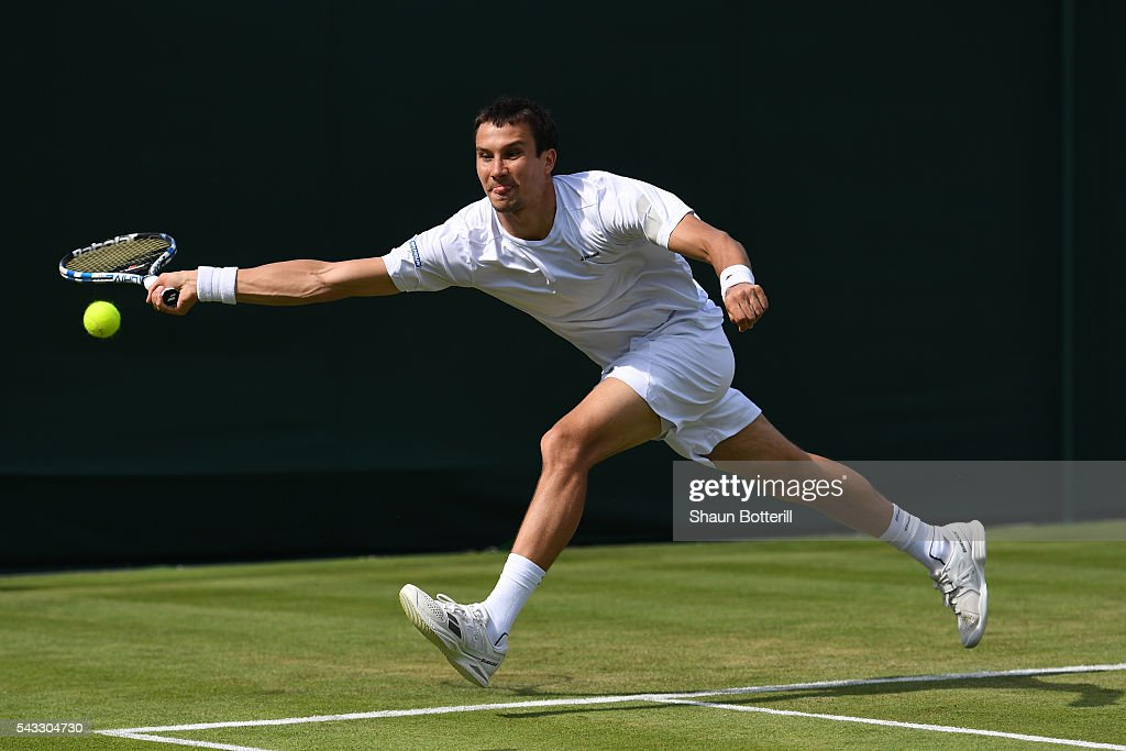<a gi-track='captionPersonalityLinkClicked' href=/galleries/search?phrase=Evgeny+Donskoy&family=editorial&specificpeople=5368047 ng-click='$event.stopPropagation()'>Evgeny Donskoy</a> of Russia plays a forehand shot during the Men's Singles first round against Alexandr Dolgopolov of Ukraine on day one of the Wimbledon Lawn Tennis Championships at the All England Lawn Tennis and Croquet Club on June 27th, 2016 in London, England.