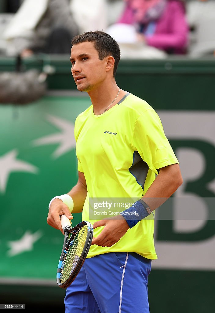 <a gi-track='captionPersonalityLinkClicked' href=/galleries/search?phrase=Evgeny+Donskoy&family=editorial&specificpeople=5368047 ng-click='$event.stopPropagation()'>Evgeny Donskoy</a> of Russia reacts during the Men's Singles first round match against David Ferrer of Spain on day three of the 2016 French Open at Roland Garros on May 24, 2016 in Paris, France.
