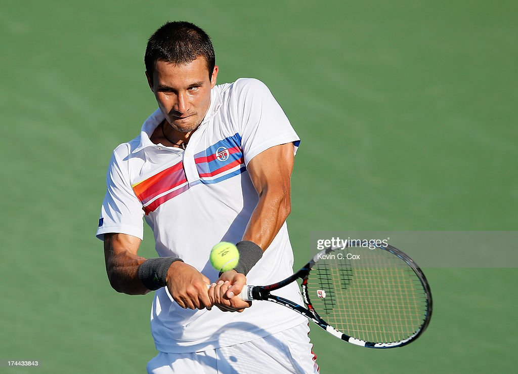 <a gi-track='captionPersonalityLinkClicked' href=/galleries/search?phrase=Evgeny+Donskoy&family=editorial&specificpeople=5368047 ng-click='$event.stopPropagation()'>Evgeny Donskoy</a> of Russia returns a backhand to James Blake during the BB&T Atlanta Open in Atlantic Station on July 25, 2013 in Atlanta, Georgia.