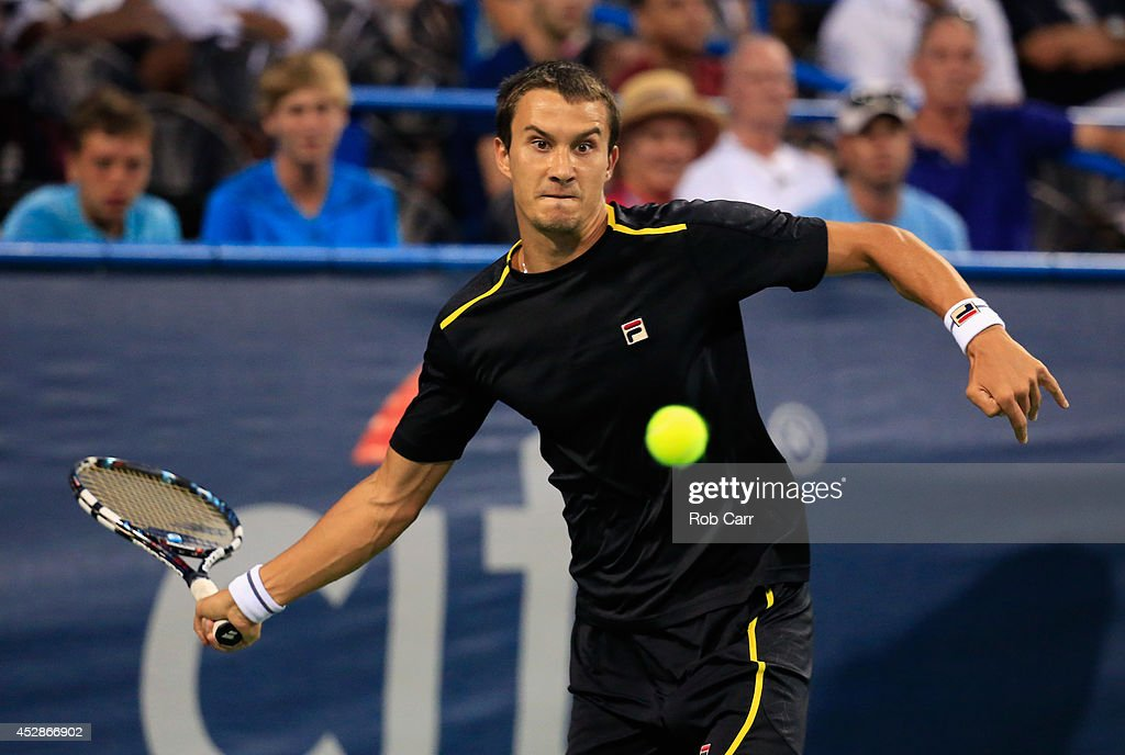 <a gi-track='captionPersonalityLinkClicked' href=/galleries/search?phrase=Evgeny+Donskoy&family=editorial&specificpeople=5368047 ng-click='$event.stopPropagation()'>Evgeny Donskoy</a> of Russia returns a shot to <a gi-track='captionPersonalityLinkClicked' href=/galleries/search?phrase=Francis+Tiafoe&family=editorial&specificpeople=10095812 ng-click='$event.stopPropagation()'>Francis Tiafoe</a> of the United States during the Citi Open at the William H.G. FitzGerald Tennis Center on July 28, 2014 in Washington, DC.