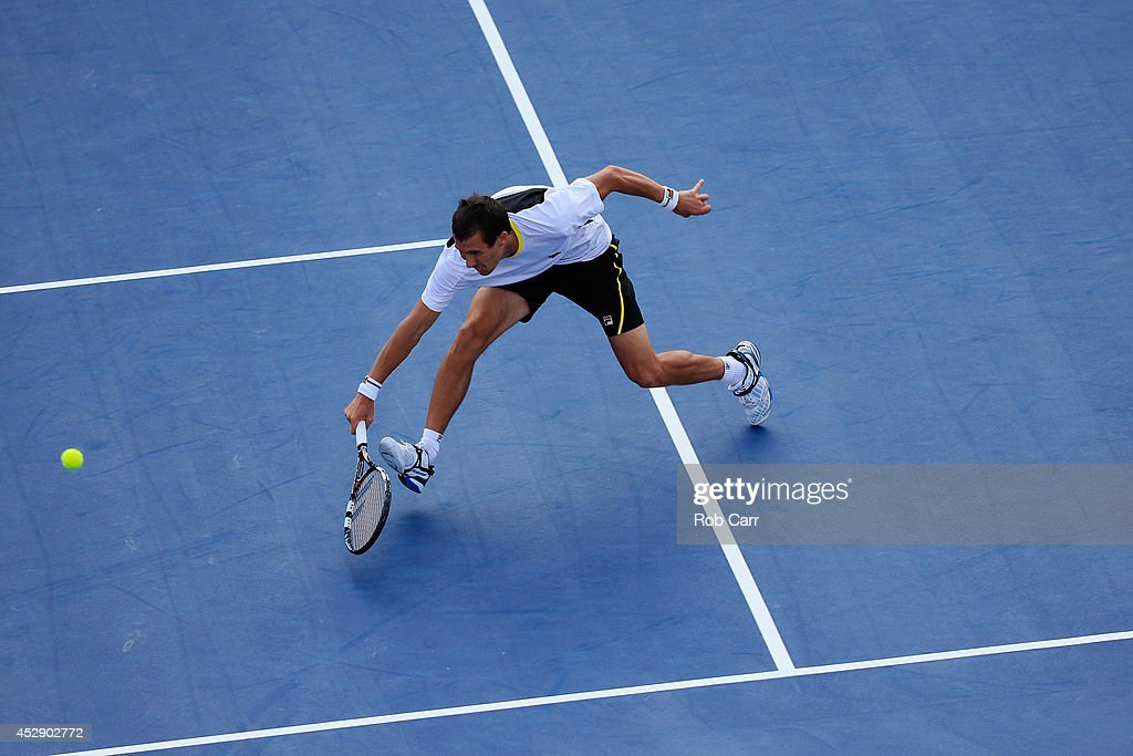 <a gi-track='captionPersonalityLinkClicked' href=/galleries/search?phrase=Evgeny+Donskoy&family=editorial&specificpeople=5368047 ng-click='$event.stopPropagation()'>Evgeny Donskoy</a> of Russia returns a shot to Kevin Anderson of South Africa during the Citi Open at the William H.G. FitzGerald Tennis Center on July 29, 2014 in Washington, DC.