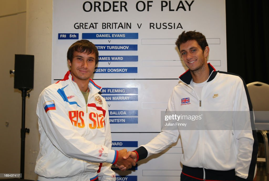 Evgeny Donskoy of Russia shakes hands with James Ward of Great Britain during previews for the Davis Cup match between Great Britain and Russia at the Ricoh Arena on April 4, 2013 in Coventry, England.