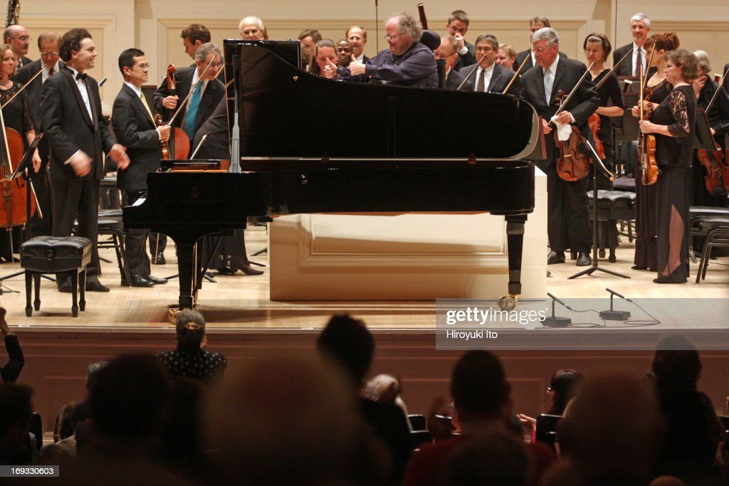 Evgeny Kissin performing Beethoven's 'Piano Concerto No. 4 in G Major' with the Met Orchestra led by James Levine at Carnegie Hall on Sunday night, May 19, 2013.This image: Mr. Levine, in center, giving two thumbs up to Mr. Kissin on far right.