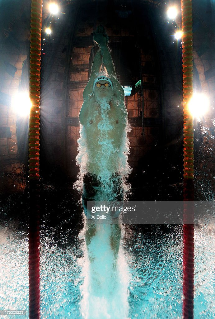 Evgeny Korotyshkin of Russia competes during the Swimming Men's 100m Butterfly preliminaries heat four on day fourteen of the 15th FINA World Championships at Palau Sant Jordi on August 2, 2013 in Barcelona, Spain.