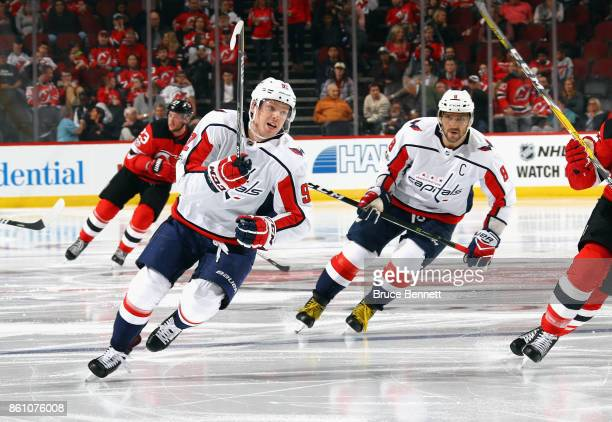 Evgeny Kuznetsov and Alex Ovechkin of the Washington Capitals skates against the New Jersey Devils at the Prudential Center on October 13 2017 in...