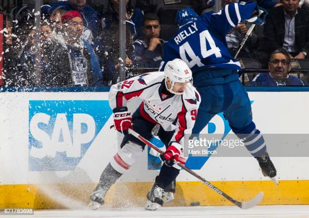 Evgeny Kuznetsov of the Washington Capitals and Morgan Rielly of the Toronto Maple Leafs battle for the puck during the first period in Game Four of...
