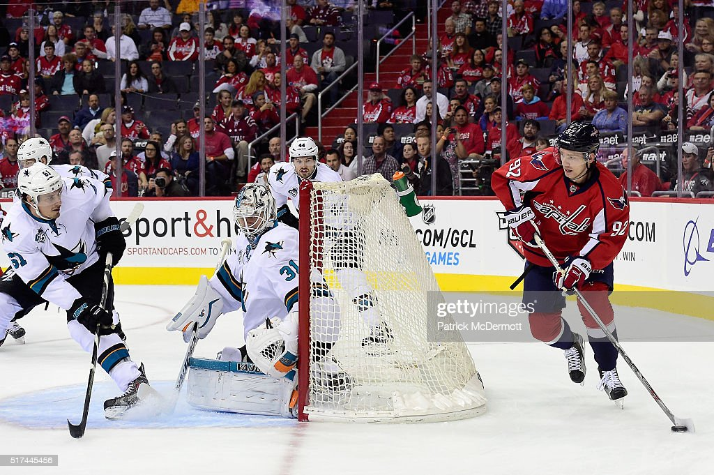 Evgeny Kuznetsov #92 of the Washington Capitals brings the puck around the net in the first period during an NHL game against the San Jose Sharks at Verizon Center on October 13, 2015 in Washington, DC.