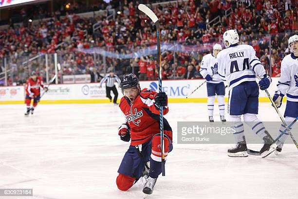 Evgeny Kuznetsov of the Washington Capitals celebrates after scoring a goal against the Toronto Maple Leafs in the third period at Verizon Center on...