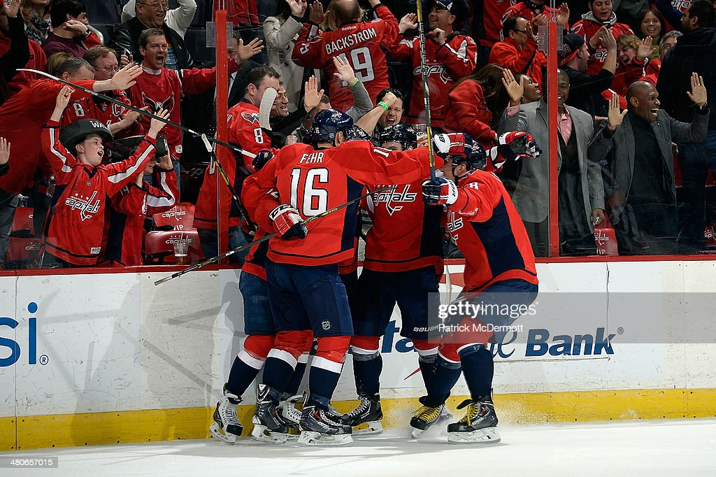 Evgeny Kuznetsov #92 of the Washington Capitals celebrates with his teammates after scoring his first career NHL goal in the third period during an NHL game against the Los Angeles Kings at Verizon Center on March 25, 2014 in Washington, DC.