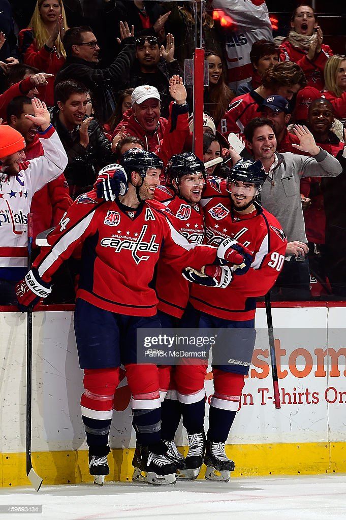 Evgeny Kuznetsov #92 of the Washington Capitals celebrates with <a gi-track='captionPersonalityLinkClicked' href=/galleries/search?phrase=Marcus+Johansson&family=editorial&specificpeople=4247883 ng-click='$event.stopPropagation()'>Marcus Johansson</a> #90 and <a gi-track='captionPersonalityLinkClicked' href=/galleries/search?phrase=Brooks+Orpik&family=editorial&specificpeople=213074 ng-click='$event.stopPropagation()'>Brooks Orpik</a> #44 after scoring a goal in the third period against the New York Islanders during an NHL game at Verizon Center on November 28, 2014 in Washington, DC.