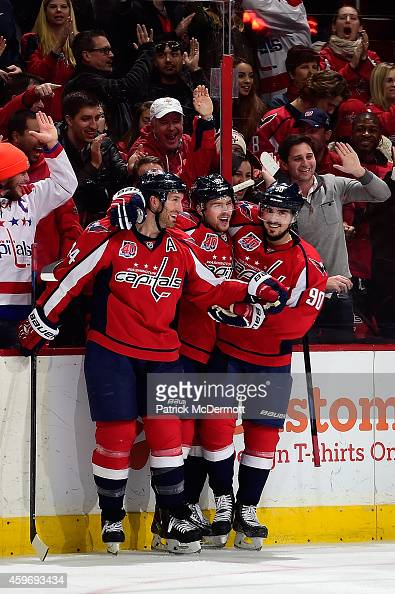 Evgeny Kuznetsov of the Washington Capitals celebrates with Marcus Johansson and Brooks Orpik after scoring a goal in the third period against the...