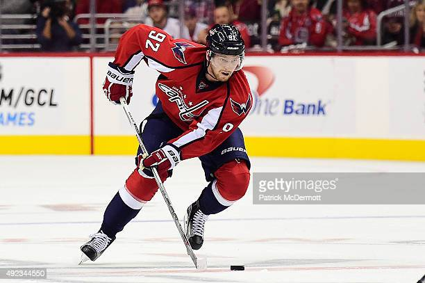 Evgeny Kuznetsov of the Washington Capitals controls the puck against the New Jersey Devils in the third period during the Capitals NHL season opener...